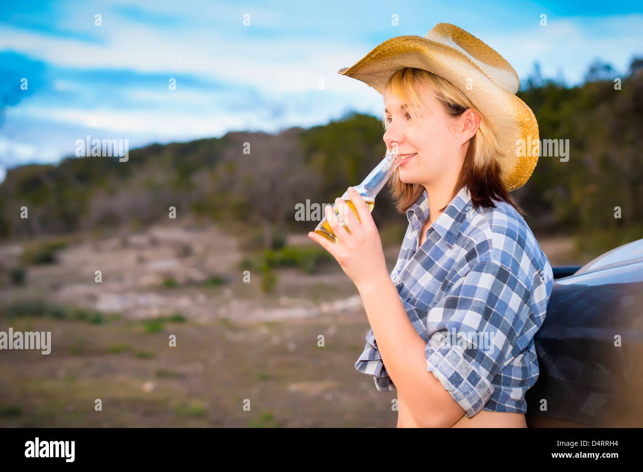Portrait of country girl holding bottle of beer, Female 19 Caucasian, Texas, USA - Stock Image