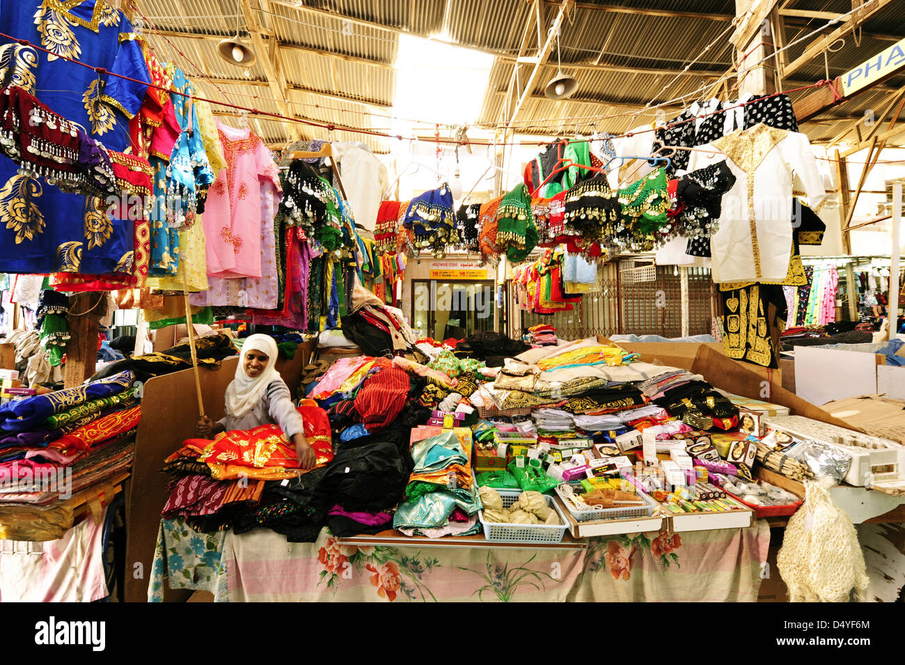 Kuwait, Kuwait City, local colorful market with traditional cloths