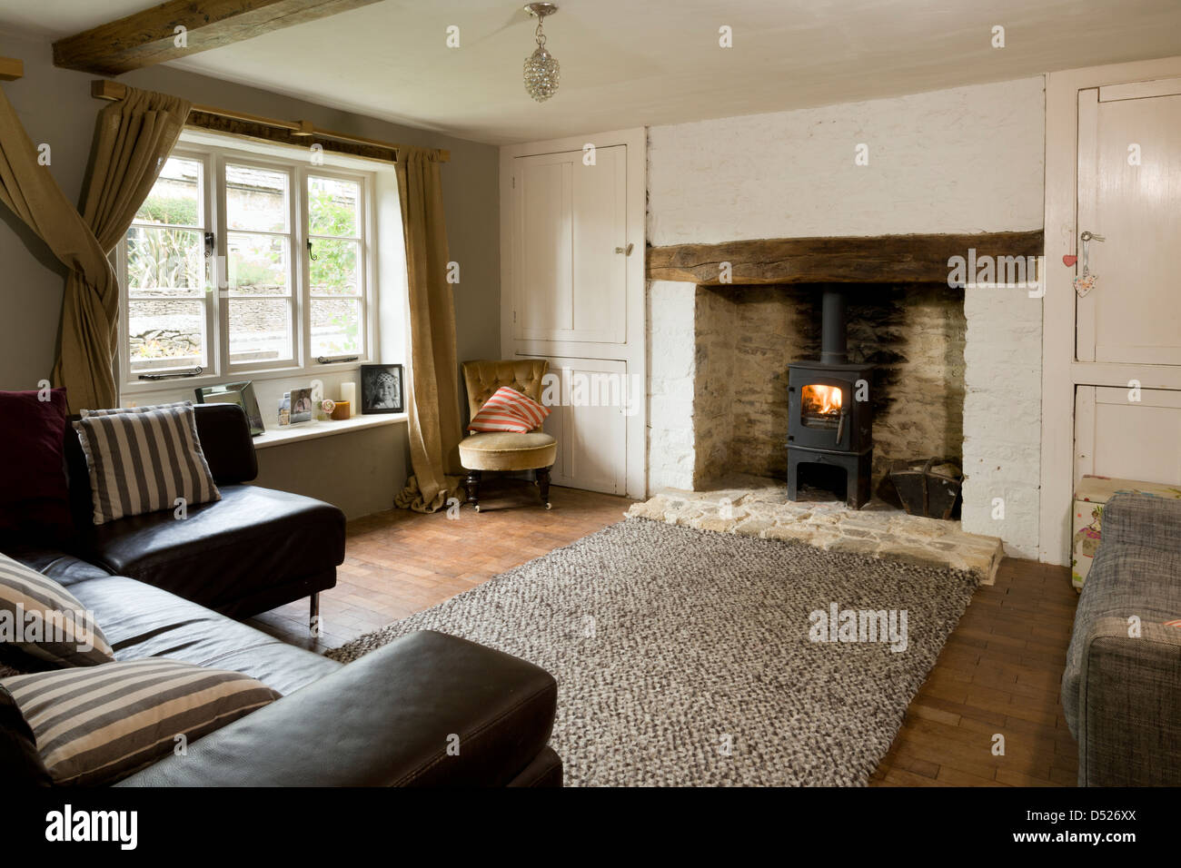 a small cottage living room with period features and modern leather sofa - Living In A Small Cottage