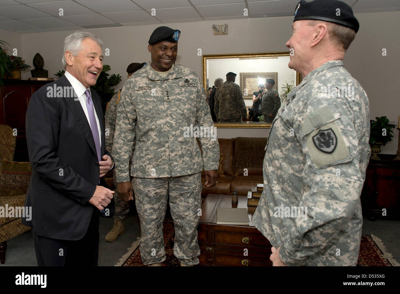 US Secretary of Defense Chuck Hagel laughs with General Lloyd Austin (center) and Joint Chiefs General Martin Dempsey - Stock Image