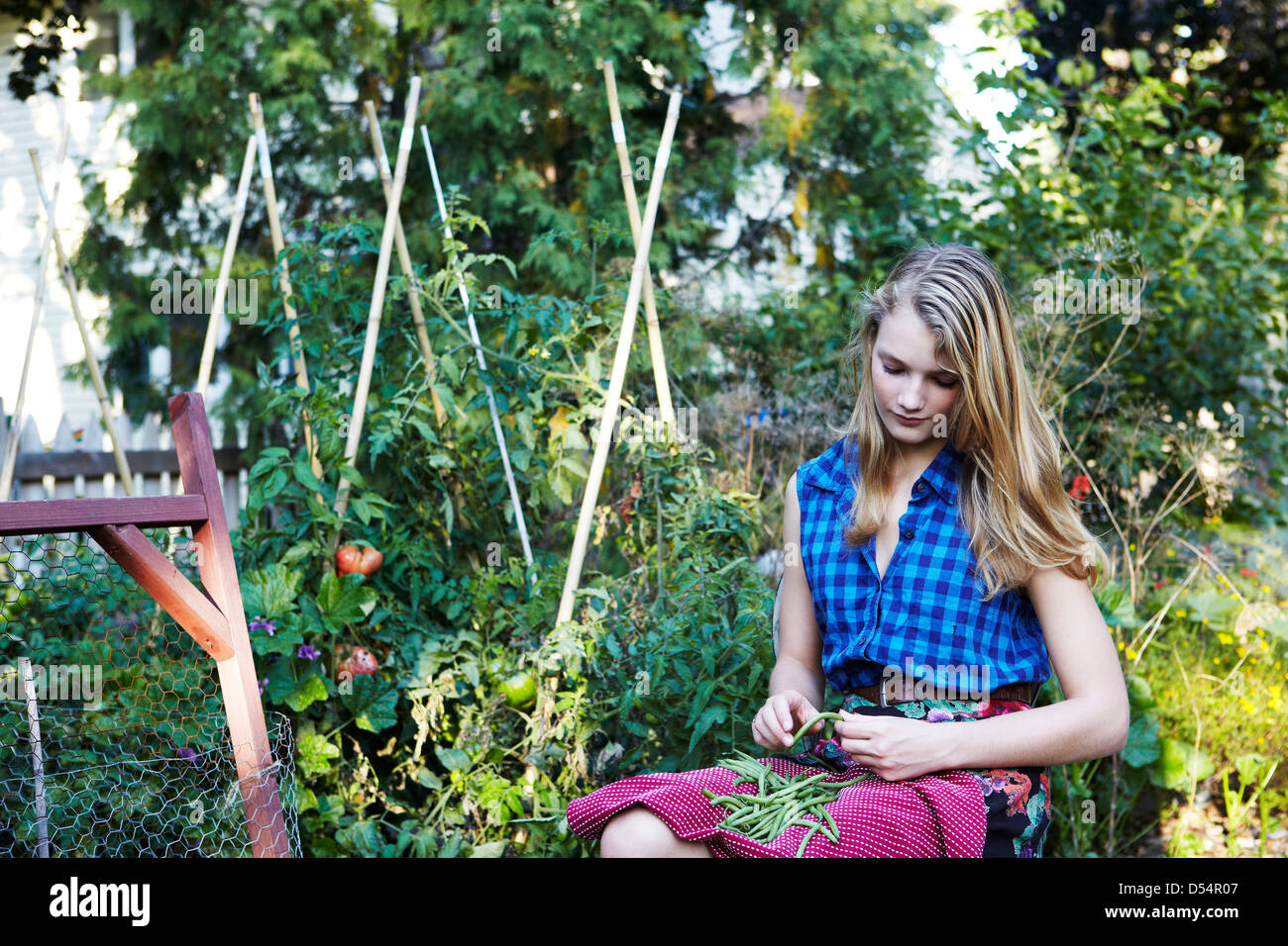 Teen girl in urban garden - Stock Image