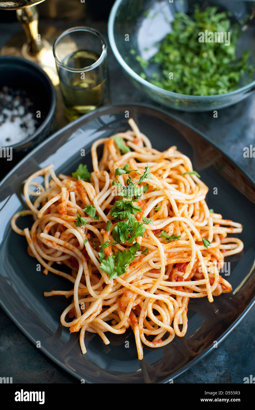 Plate of pasta with herbs - Stock Image