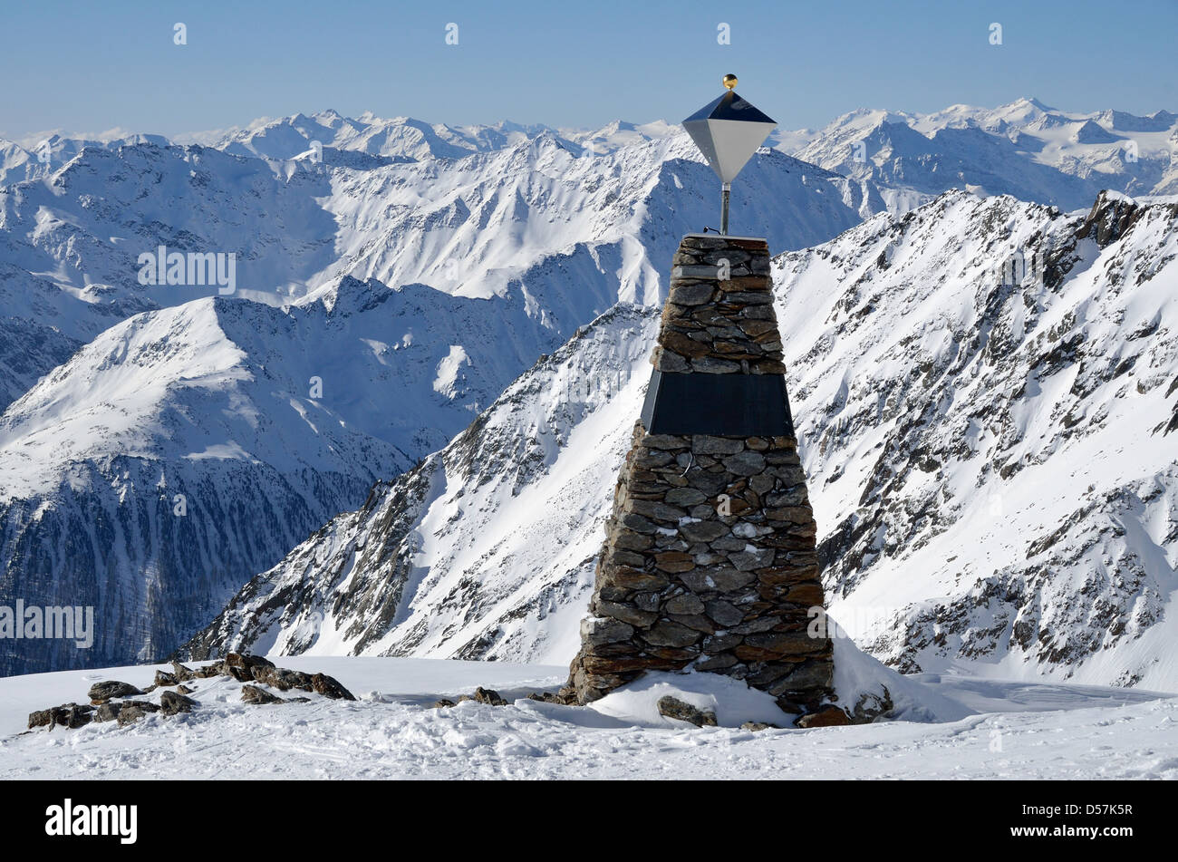 """Otzi monument in the Otztal Alps of Italy. This marks the site that mummy dubbed """"Ötzi the Iceman"""" was found in Stock Photo"""