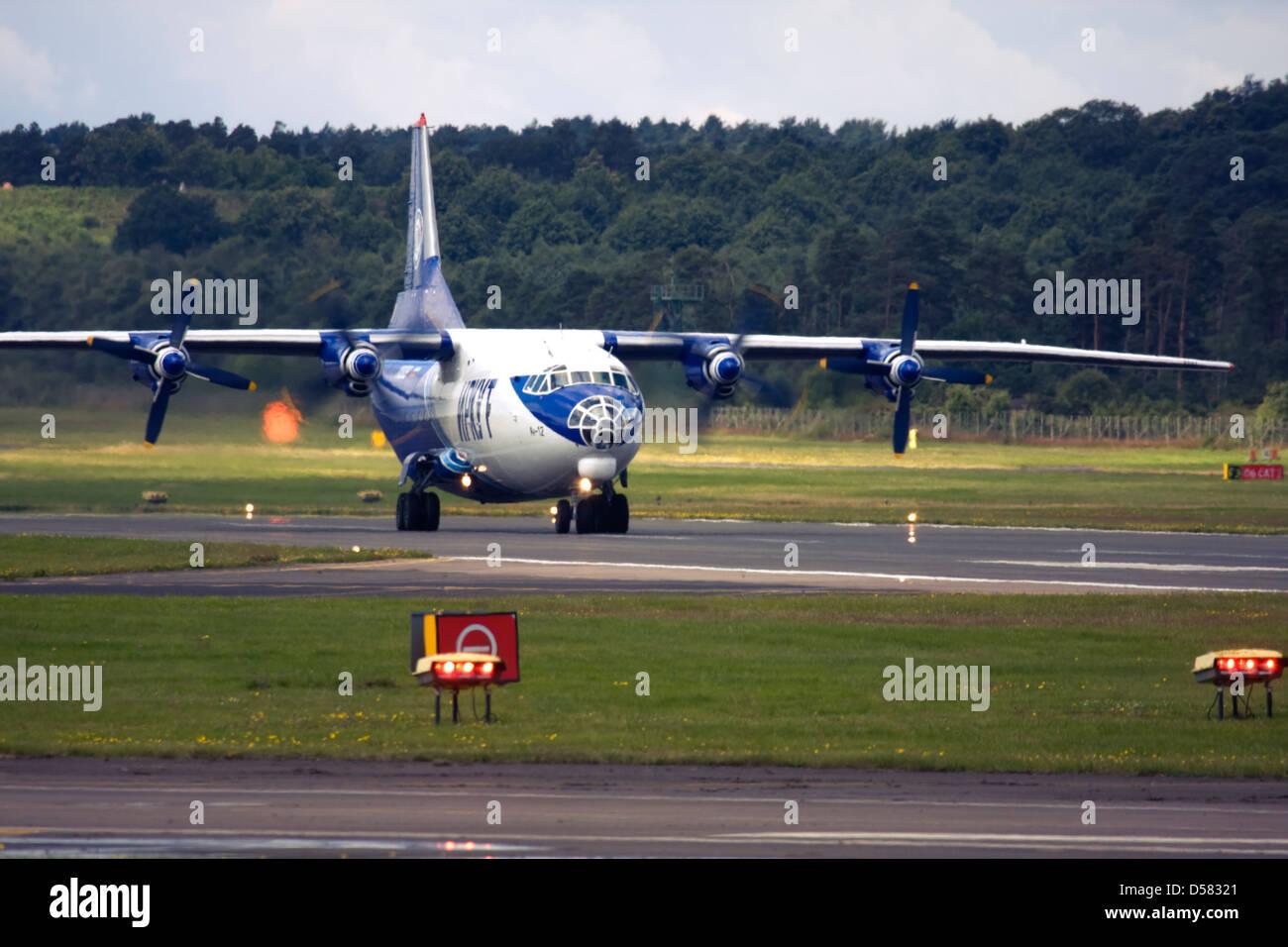 Gromov Air (Irkut-Avia) Antonov An-12 on runway at Farnborough International Airshow 2012 - Stock Image