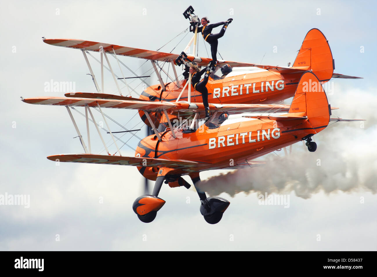 Breitling Wingwalkers British aerobatics and wingwalking team performing at Farnborough Airshow 2012, UK - Stock Image