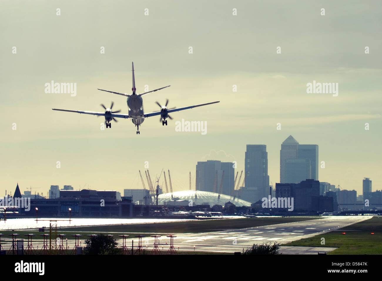 Commercial airplane landing at London City Airport, England, UK. Stock Photo