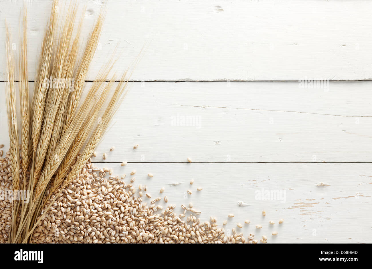 barley with pearl barley against white wood background - Stock Image