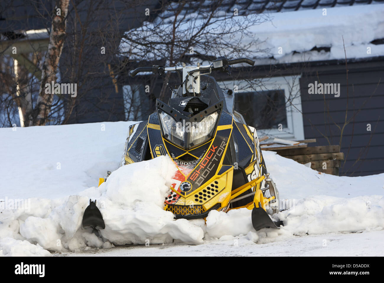 crashed damaged snowmobile kirkenes finnmark norway europe - Stock Image