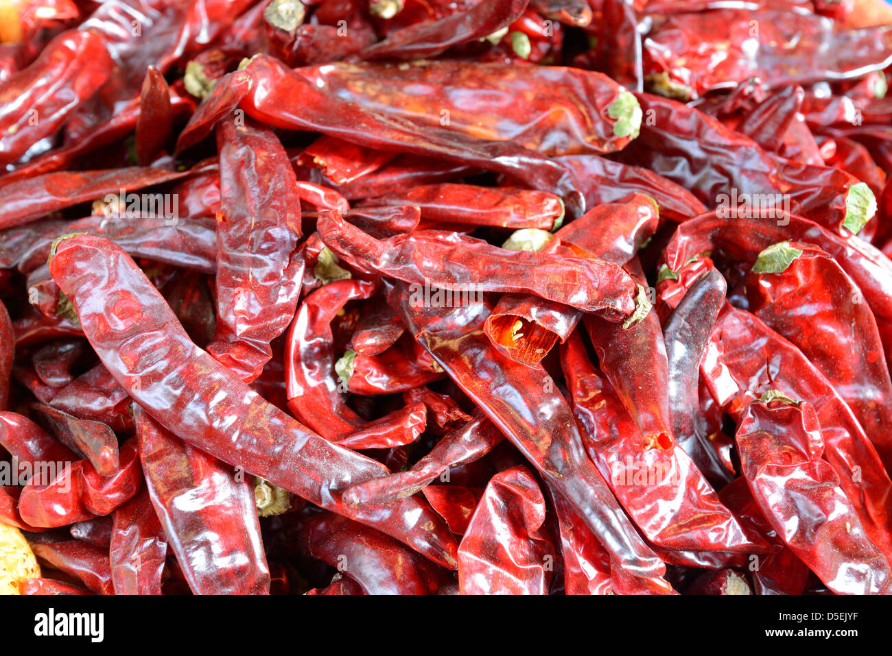 pile of spicy peppers at a market - Stock Image