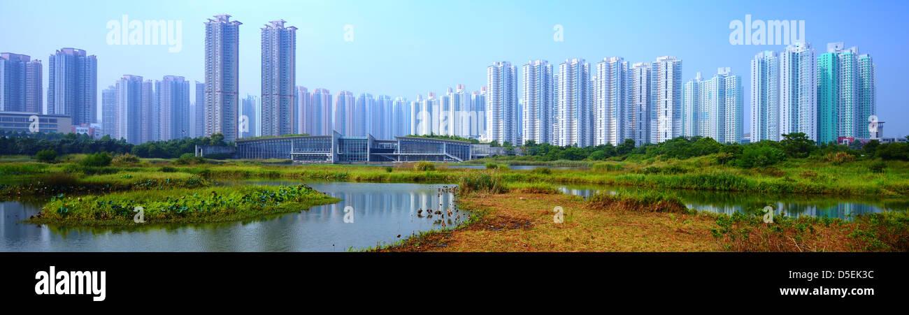 High rise apartments above Wetland Park in Hong Kong, China. - Stock Image