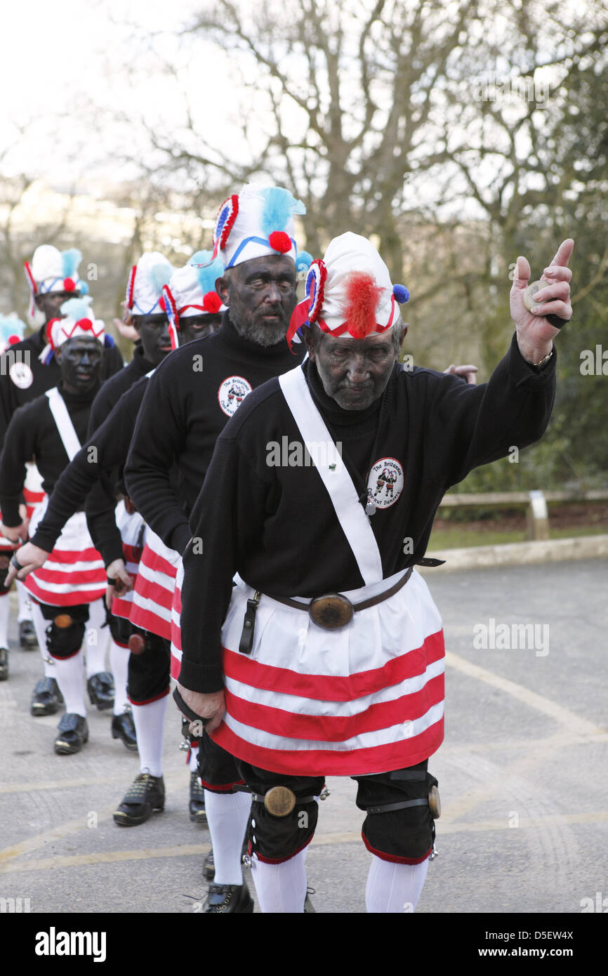 Britannia Coco-nut Dancers of Bacup, accompanied by Stacksteads Silver Band, dance their way around Bacup, UK on Stock Photo