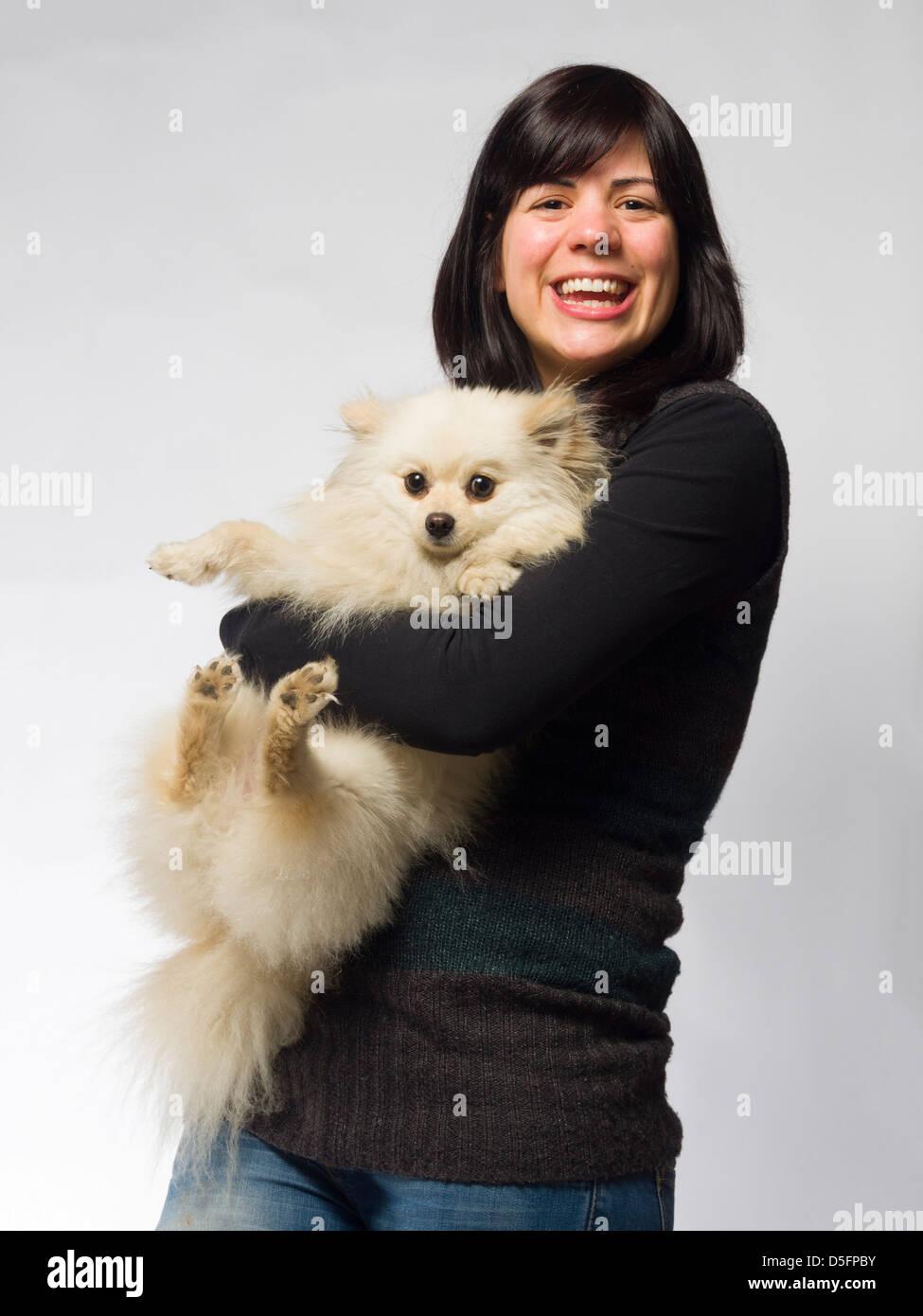 Woman Holding Small White Pomeranian Dog Stock Photo 55051247 Alamy