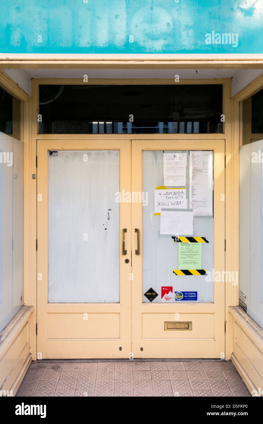 Empty shop with white washed windows and posters and notices on the door - Stock Image & Posters On Street Door Stock Photos \u0026 Posters On Street Door Stock ...