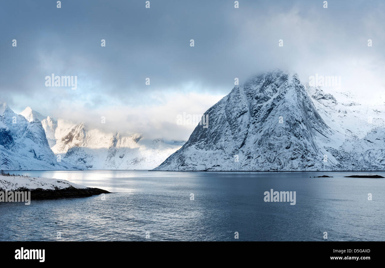 A view of mount Olstind on the Lofoten islands on a winter morning - Stock Image