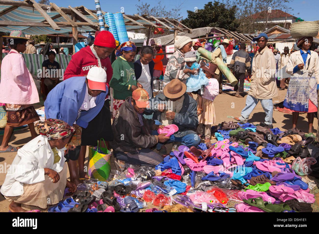 Madagascar, Ambositra, Marche Sandrandahy market, customers at shoe stall Stock Photo