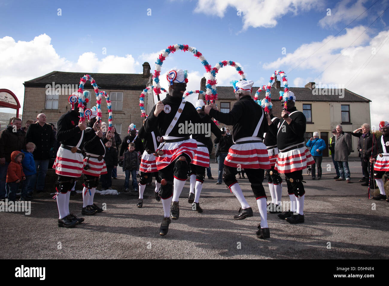 The  Morrismen of the Britannia Coconutters dance boundary to boundary in Bacup , Lancashire . Coconut Stock Photo
