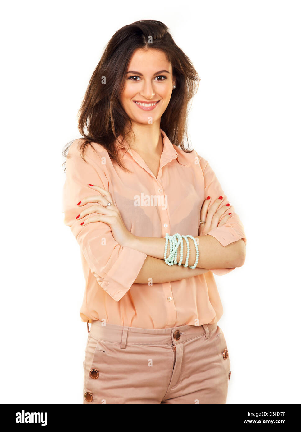 Corporate woman with arms folded against white background - Stock Image