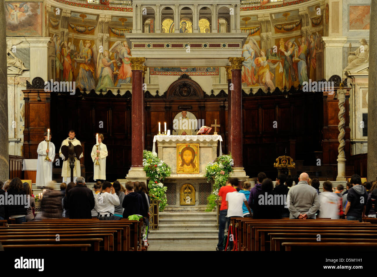 italy, rome, basilica of santa maria in trastevere, catholic mass - Stock Image