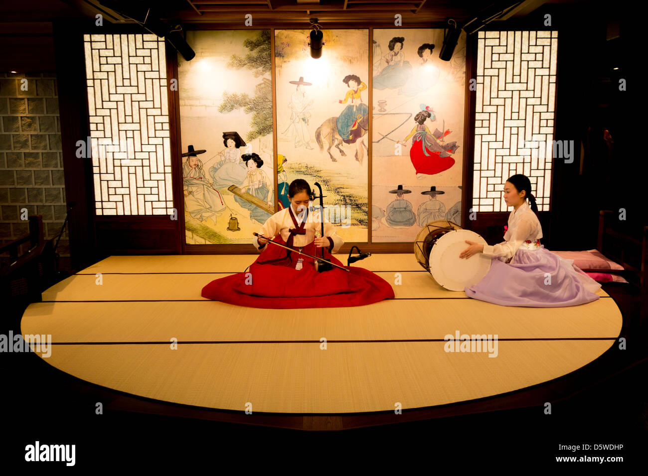 Korean women play traditional music and song in departure lounge of Inchon Airport Seoul South Korea to entertain - Stock Image