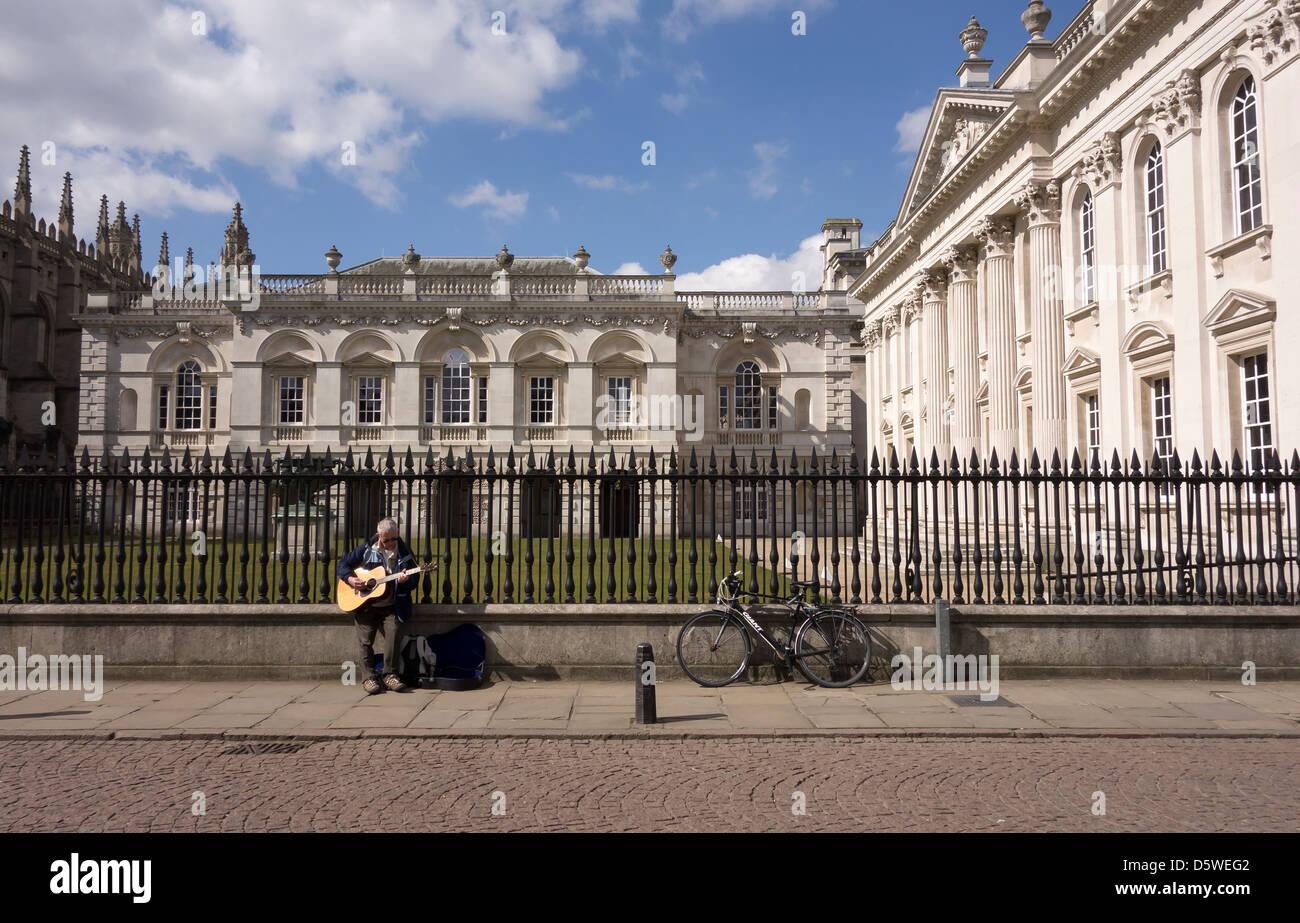 street-entertainer-playing-guitar-in-front-of-old-law-schools-cambridge-D5WEG2.jpg