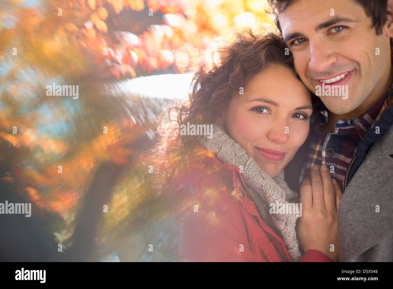 Couple hugging in park - Stock Image