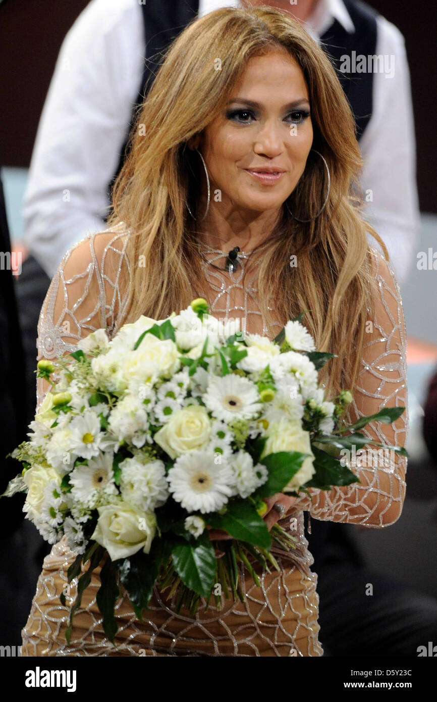 Us singer jennifer lopez holds a bouquet of flowers during the 200th us singer jennifer lopez holds a bouquet of flowers during the 200th episode of the zdf television show wetten dass wanna bet that at iss dome izmirmasajfo