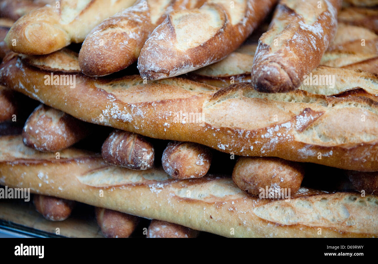 Close up of pile of baguettes for sale - Stock Image
