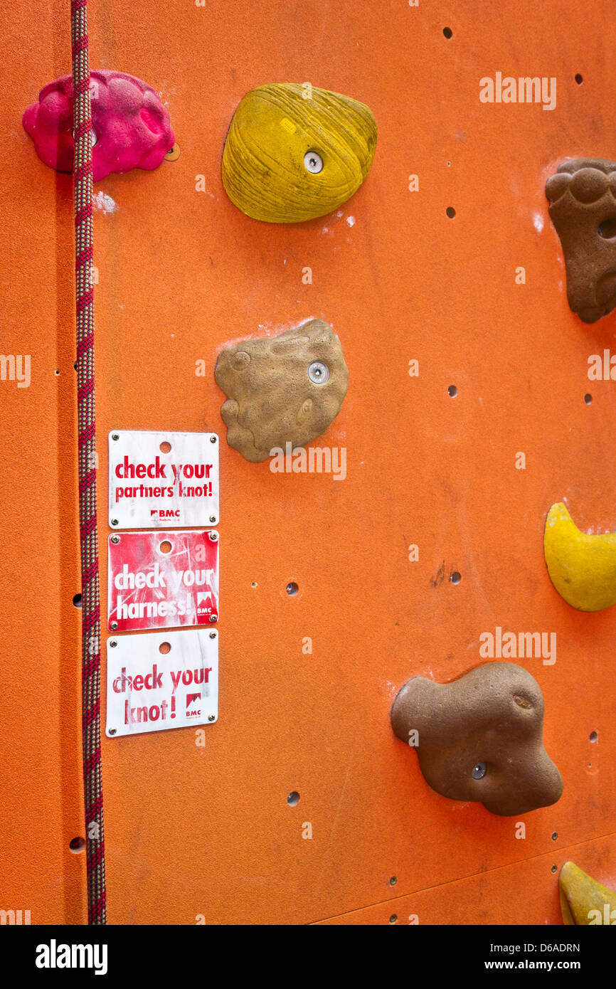 Detail of climbing holds on an indoor climbing wall - Stock Image