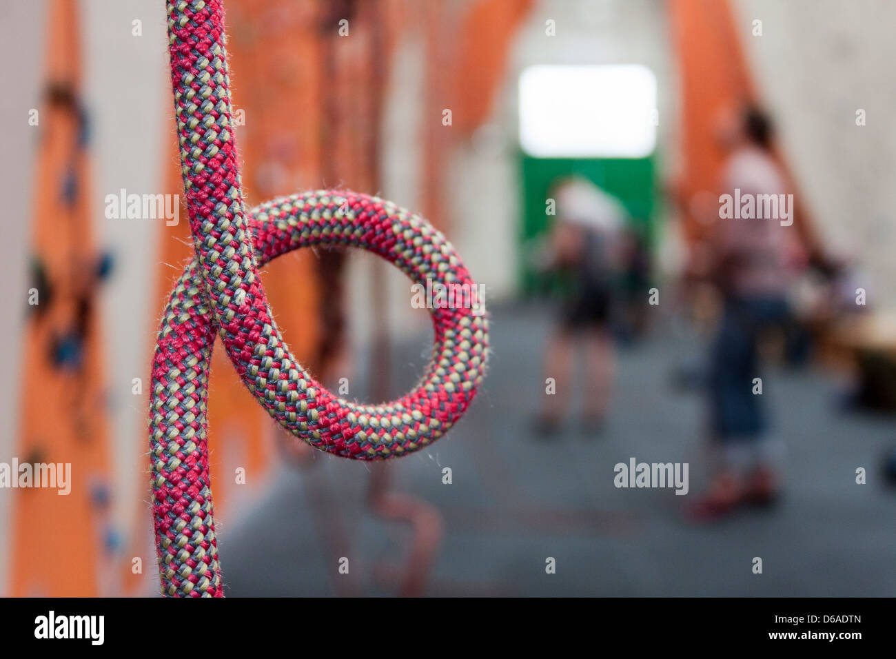 Detail of climbing rope on an indoor climbing wall. - Stock Image