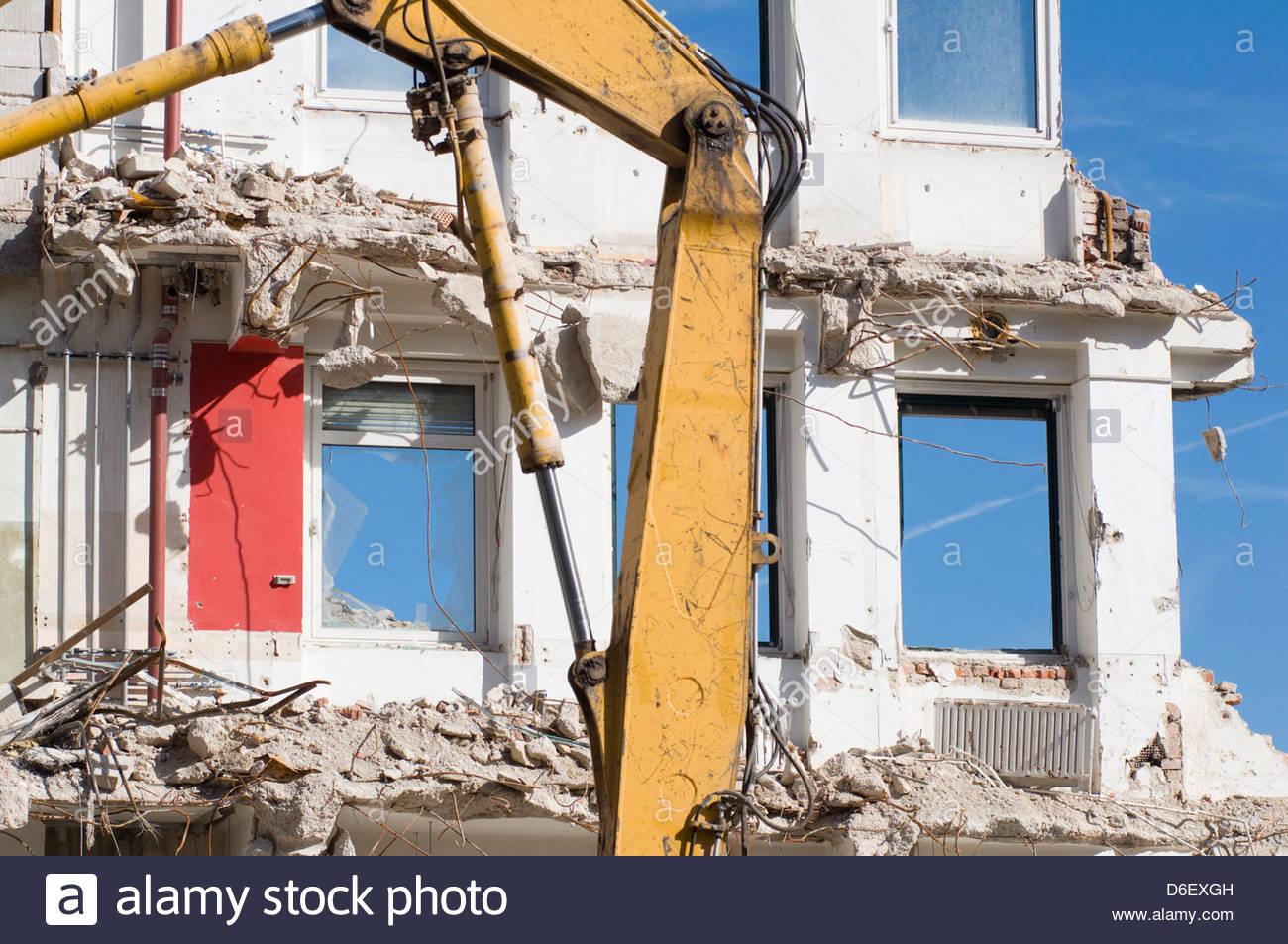 Demolition site digger building destruction old - Stock Image
