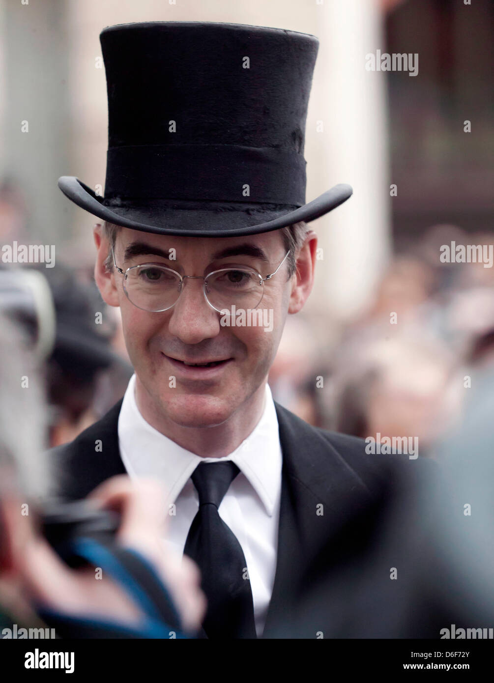 Jacob Rees-Mogg, wearing a top hat, waits to enter St Paul's Cathedral for Baroness Thatcher funeral Stock Photo