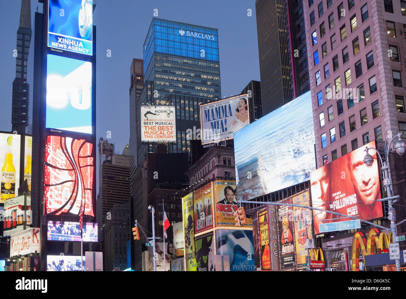 Illuminated billboards in Times Square - Stock Image