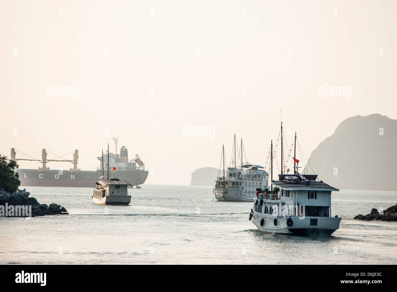 Shipping in Halong Bay, UNESCO World Heritage Site, Vietnam, Indochina, Southeast Asia, Asia - Stock Image