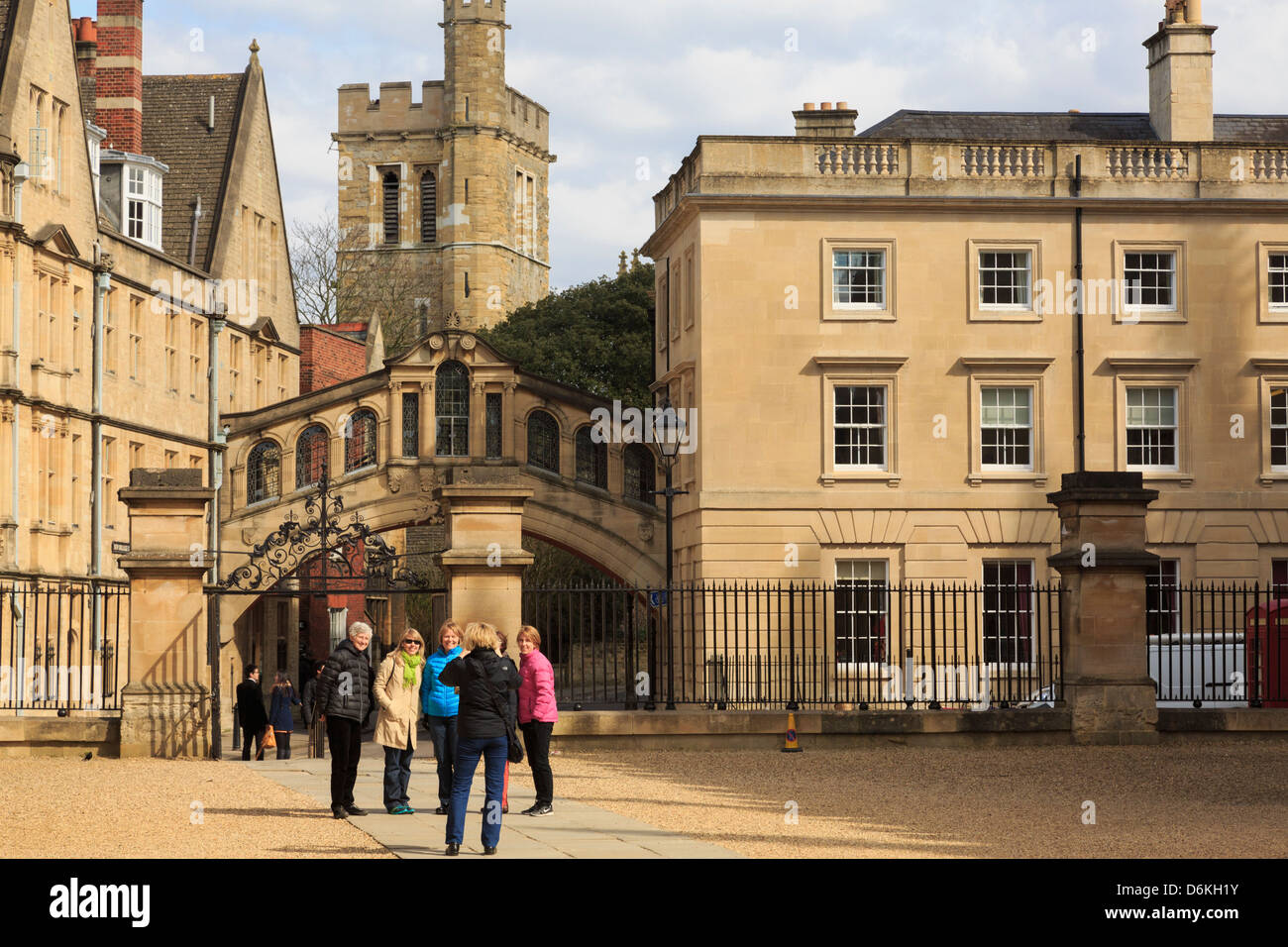 Tourists being photographed in front of the Bridge of Sighs and Hertford College in Oxford England UK Britain - Stock Image