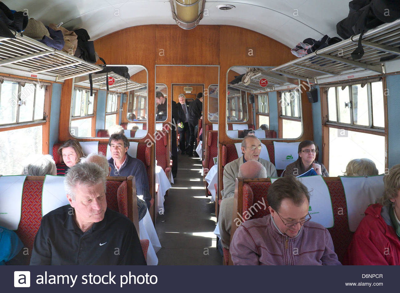 Passengers travel in old coaches on a special steam hauled train excursion from London to north Wales, UK. Stock Photo