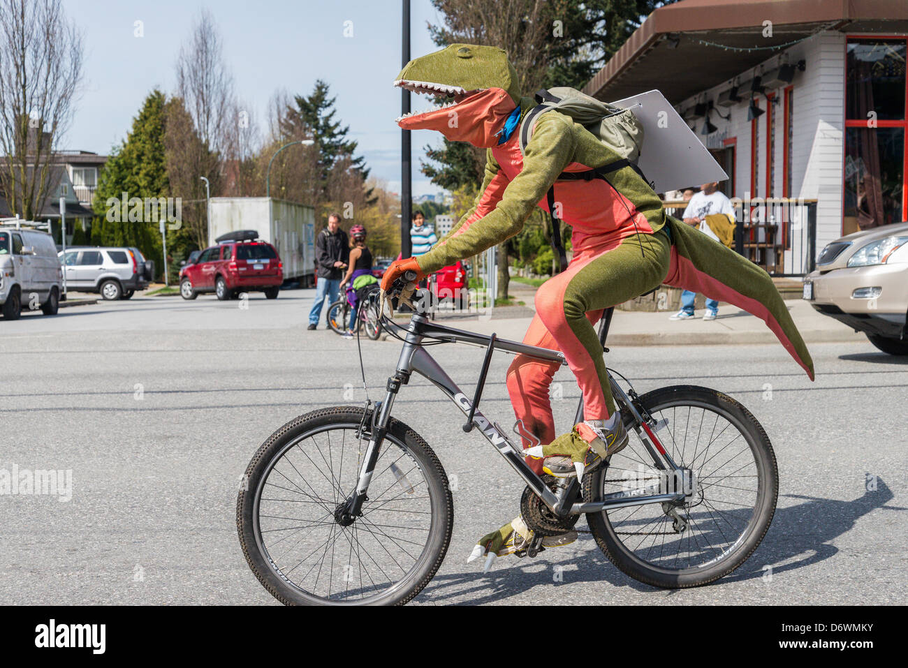 Dinosaurs against fossil fuels at Vancouver Earth Day Parade and Festival 2013 - Stock Image