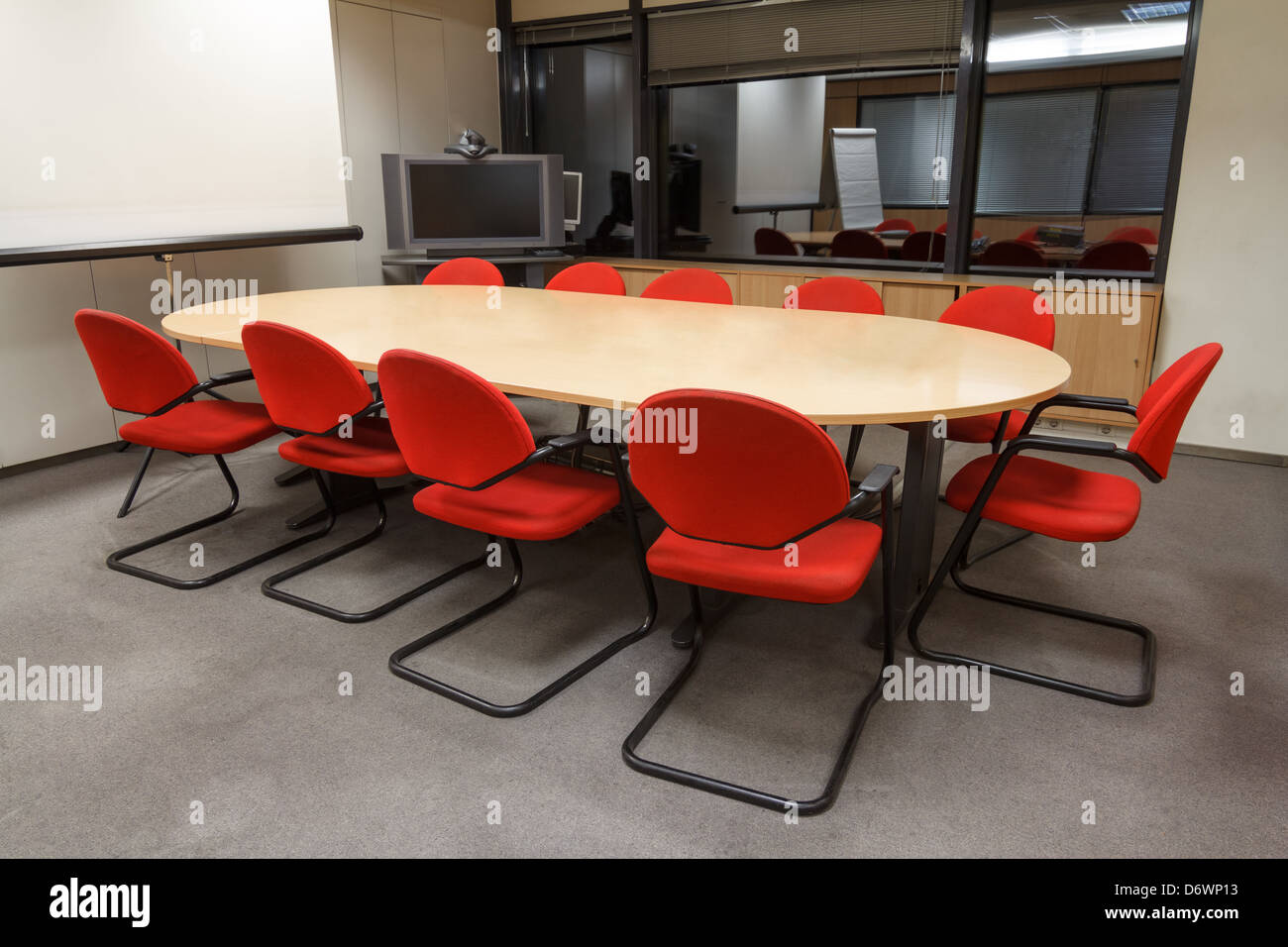 Small Meeting Room With Table And Chairs And Projector Screen Stock - Small conference table with chairs