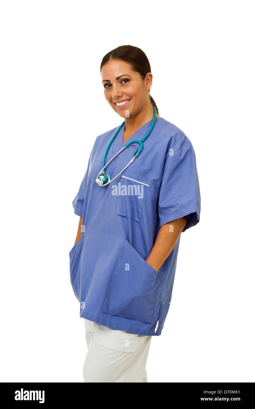 Female doctor smiling with hands in pockets isolated on white. - Stock Image