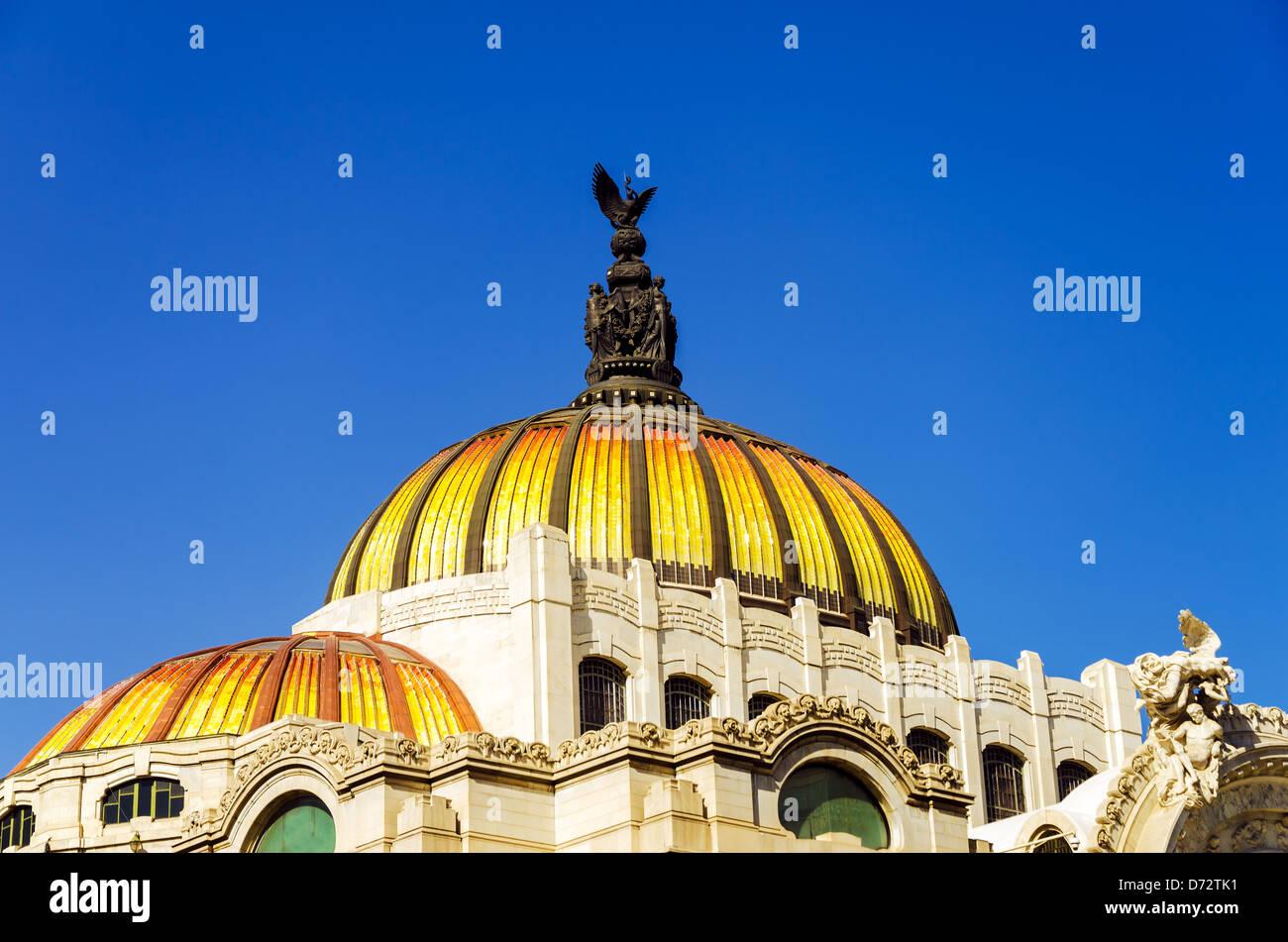 The orange and yellow dome of the Palacio de las Bellas Artes in Mexico City - Stock Image