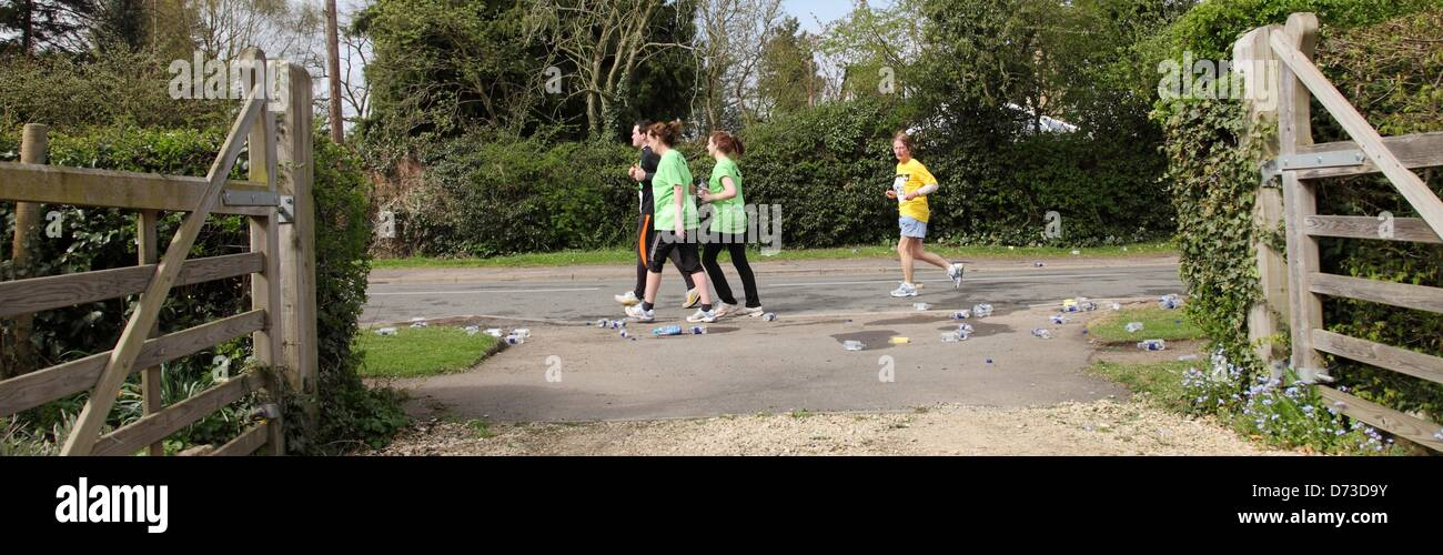 Sunday 28th April, Welford on Avon, UK. Stragglers bring up the tail end of the Shakespeare Marathon at Welford Stock Photo