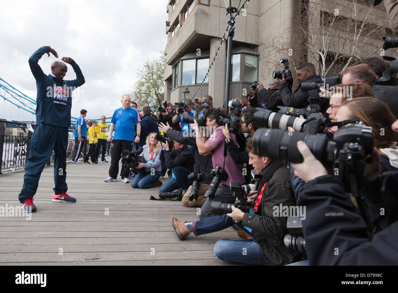 double-olympic-gold-medal-winner-mo-farah-attends-a-photocall-before-D7998C.jpg