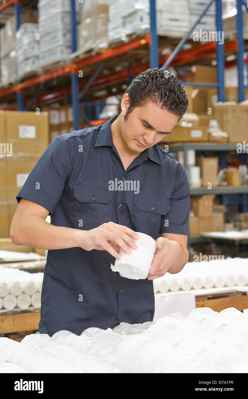 Factory Worker Checking Goods On Production Line - Stock Image
