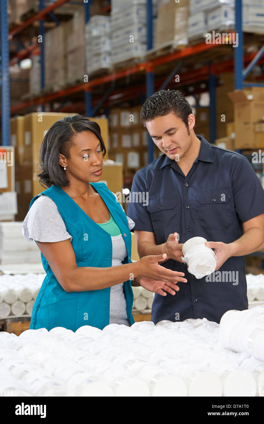 Factory Worker Training Colleague On Production Line - Stock Image