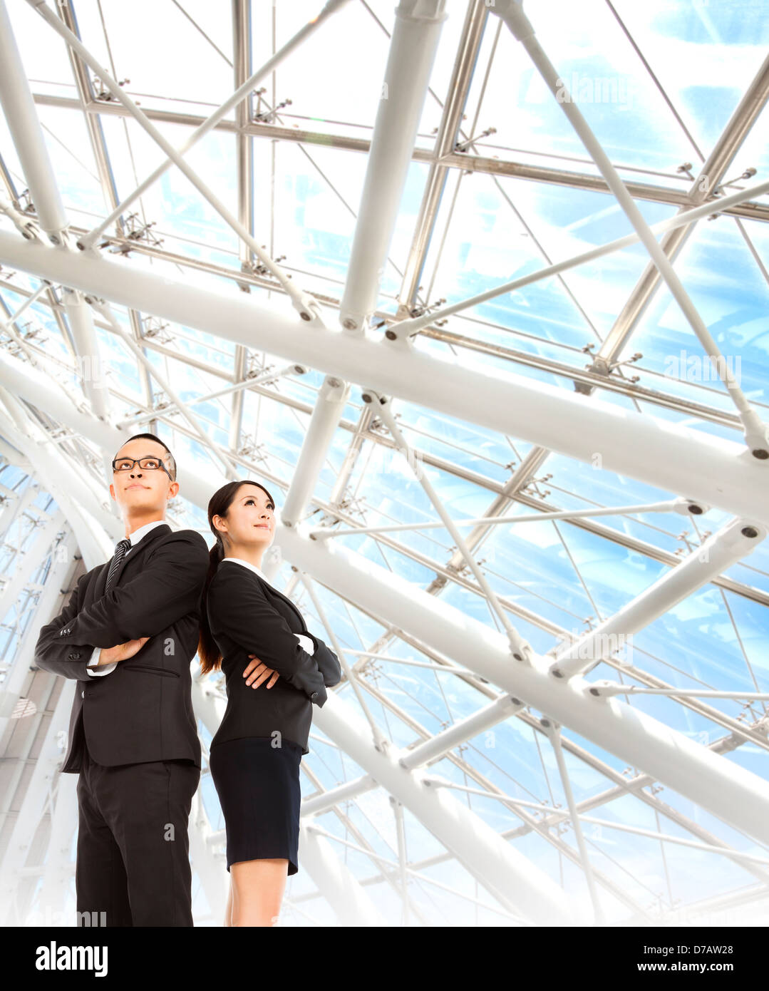 young businessman and businesswoman stand in the modern office - Stock Image
