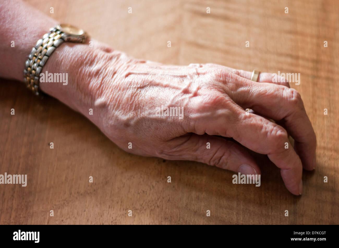 Germany, Hesse, Frankfurt, Human hand on table - Stock Image