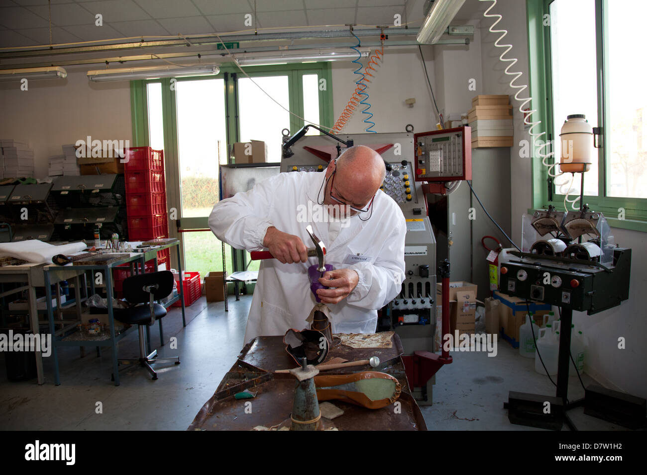Teacher at work at Cercal footwear school and research center, San Mauro Pascoli, Emilia-Romagna, Italy - Stock Image