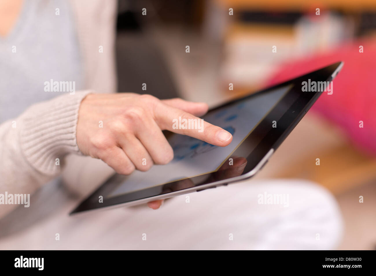 Female holding digital tablet, closeup - Stock Image