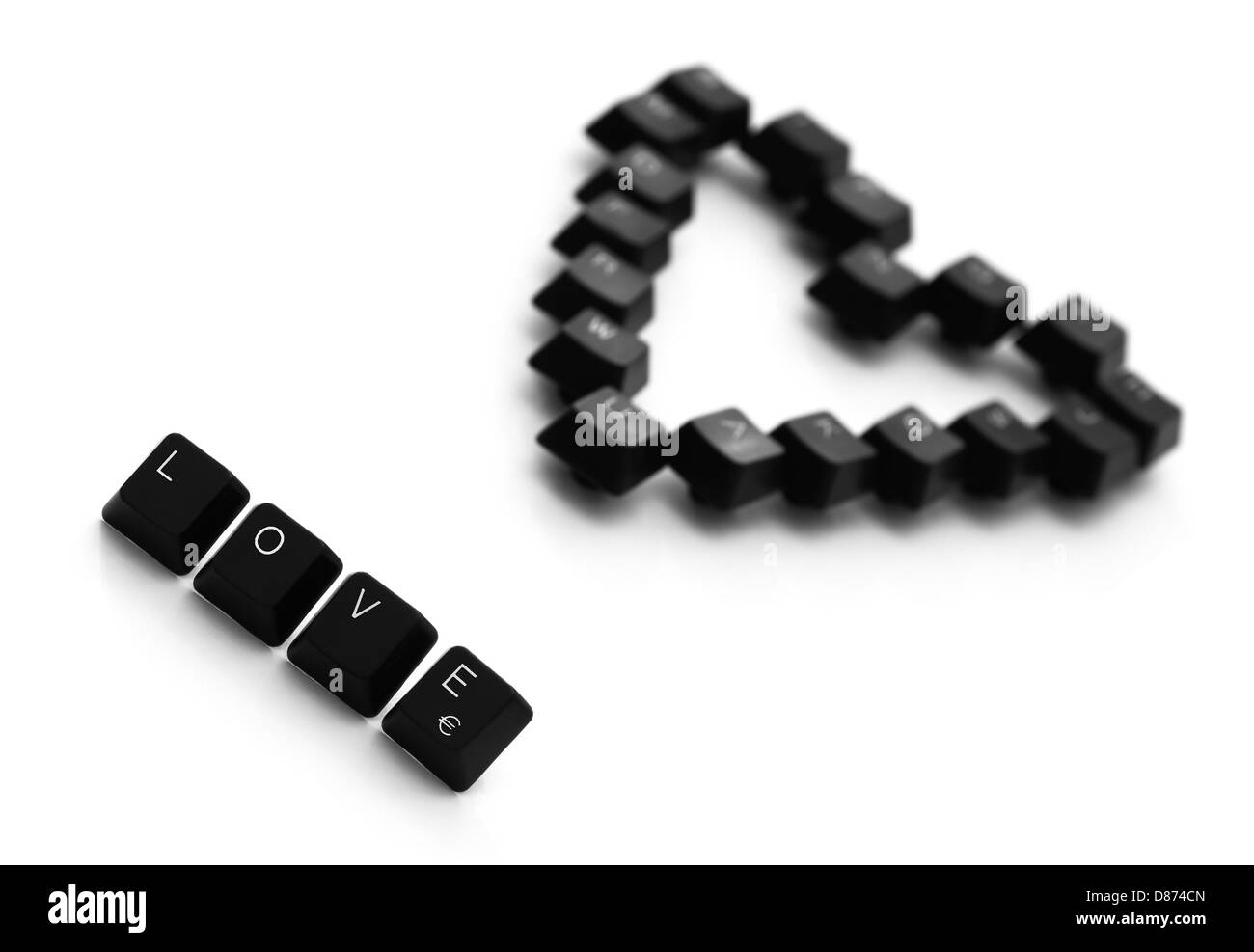 Love Sign And Heart Made Of Keyboard Keys On A White Background