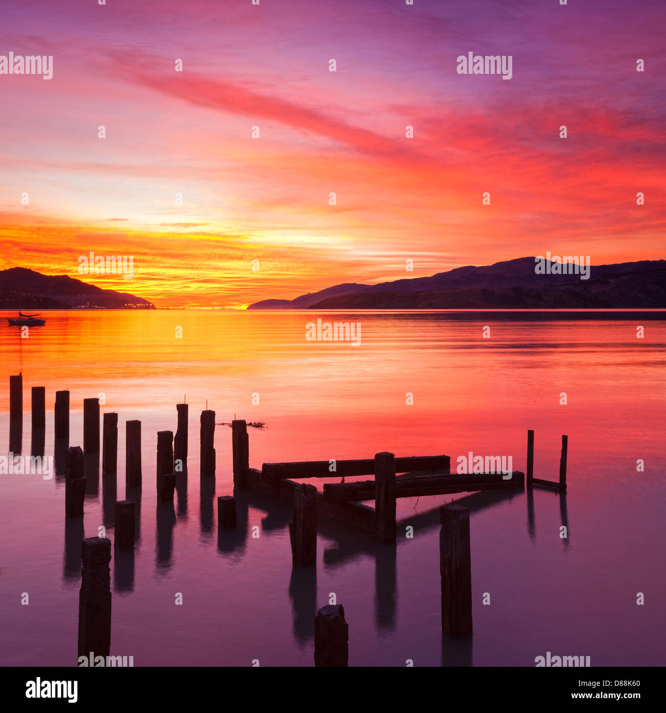 Beautiful sunset with colours of red, orange and yellow, over Governors Bay, Canterbury New Zealand, looking towards - Stock Image