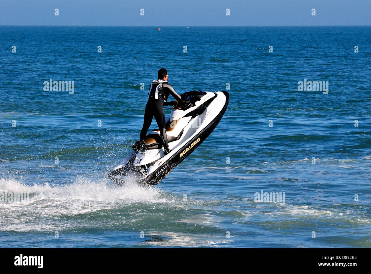man-riding-a-jetski-dorset-england-uk-D892B5.jpg